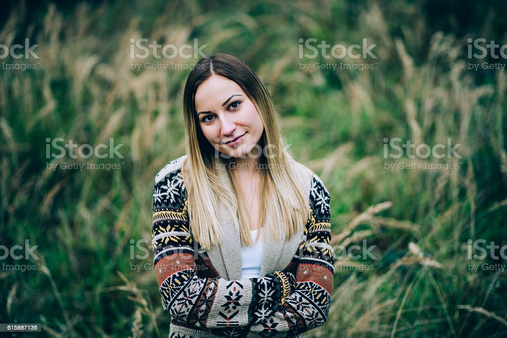 girl portrait in field stock photo