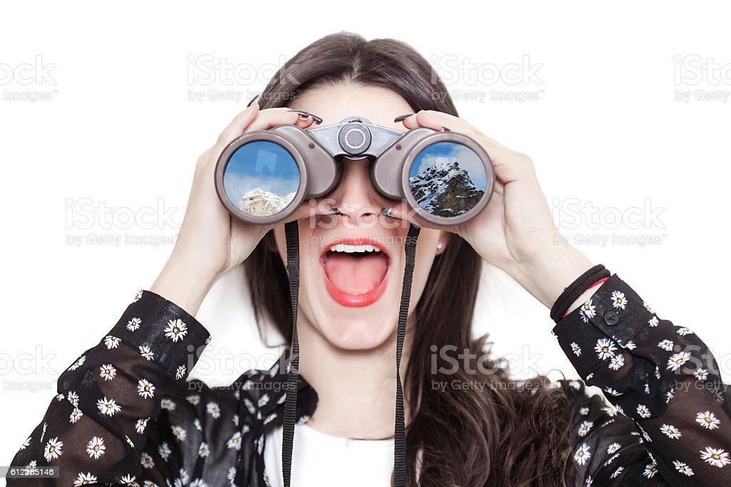 Girl portrait looking at mountains through binoculars stock photo