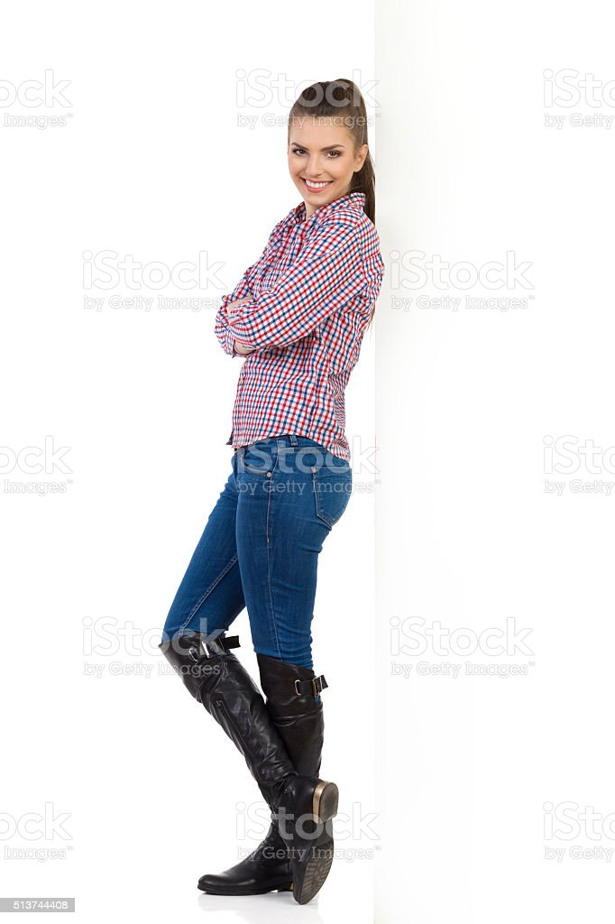 Girl Posing Based On A White Wall stock photo