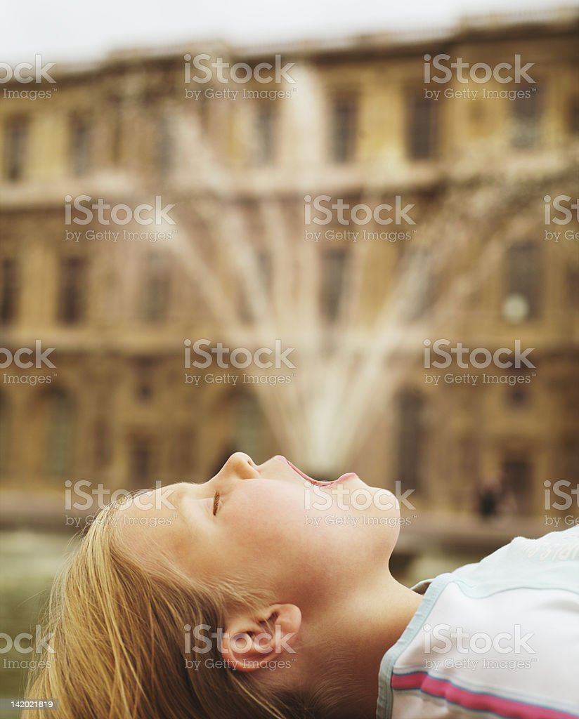 Girl posing by fountain stock photo
