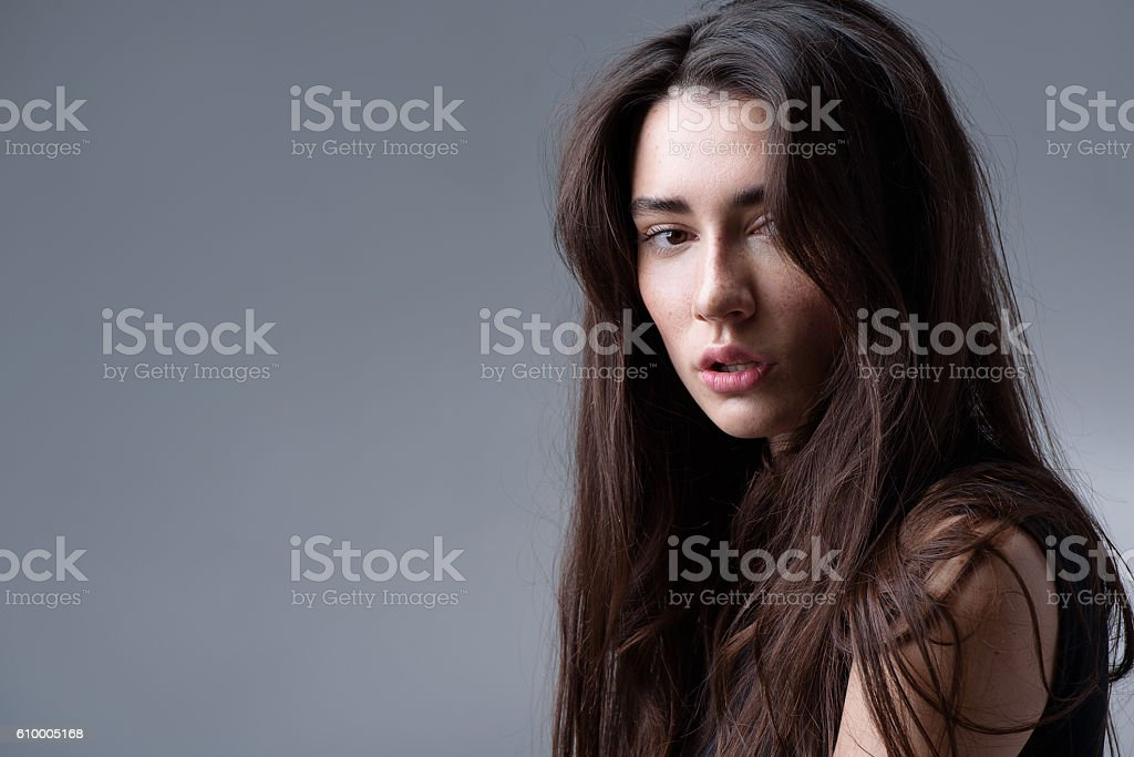 girl posing in the studio, isolated on light grey background stock photo