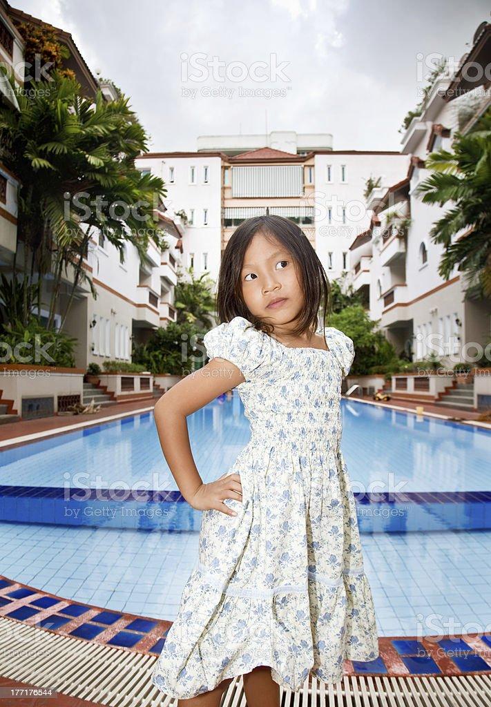 Girl posing in the yard royalty-free stock photo