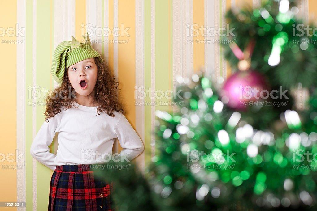 girl posing near christmas tree stock photo