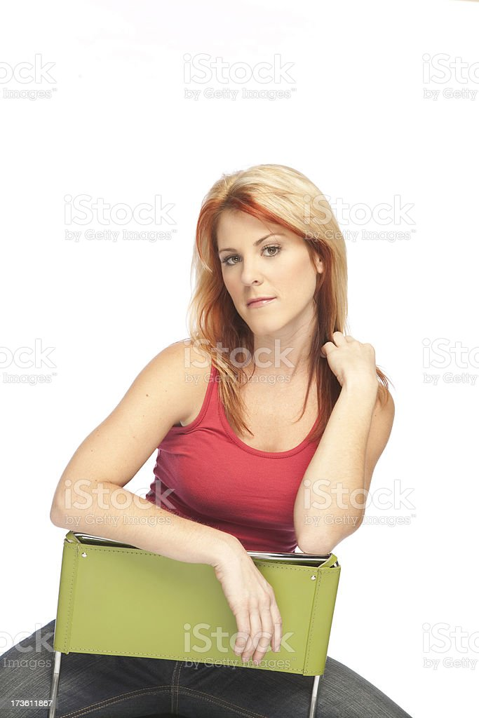 Girl Posing on Chair stock photo