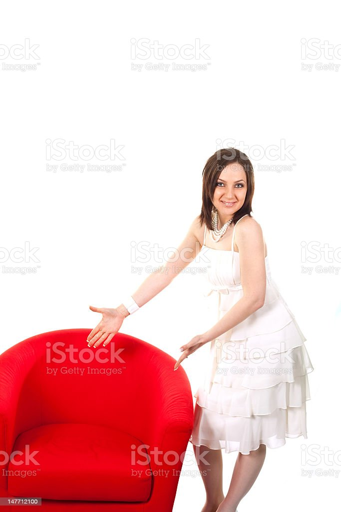 Girl posing on red sofa stock photo