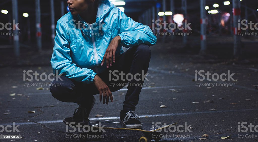 Girl posing on skateboard stock photo