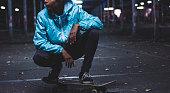 Girl posing on skateboard