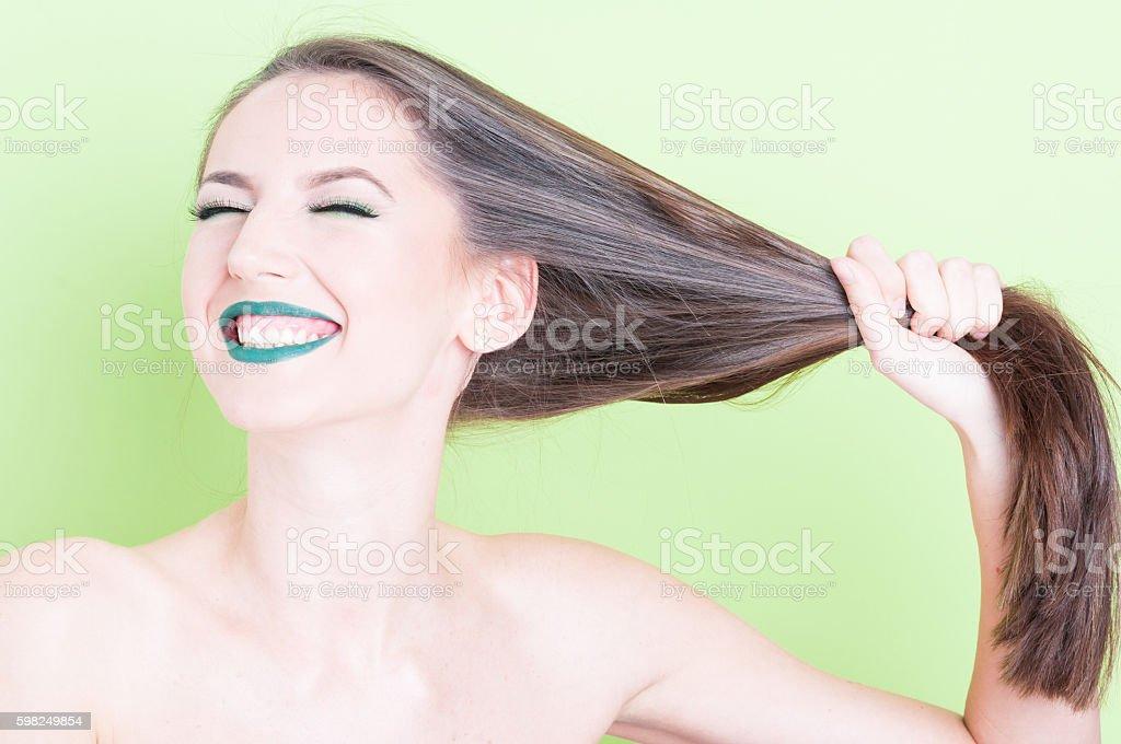 Girl posing playful pulling her hair stock photo