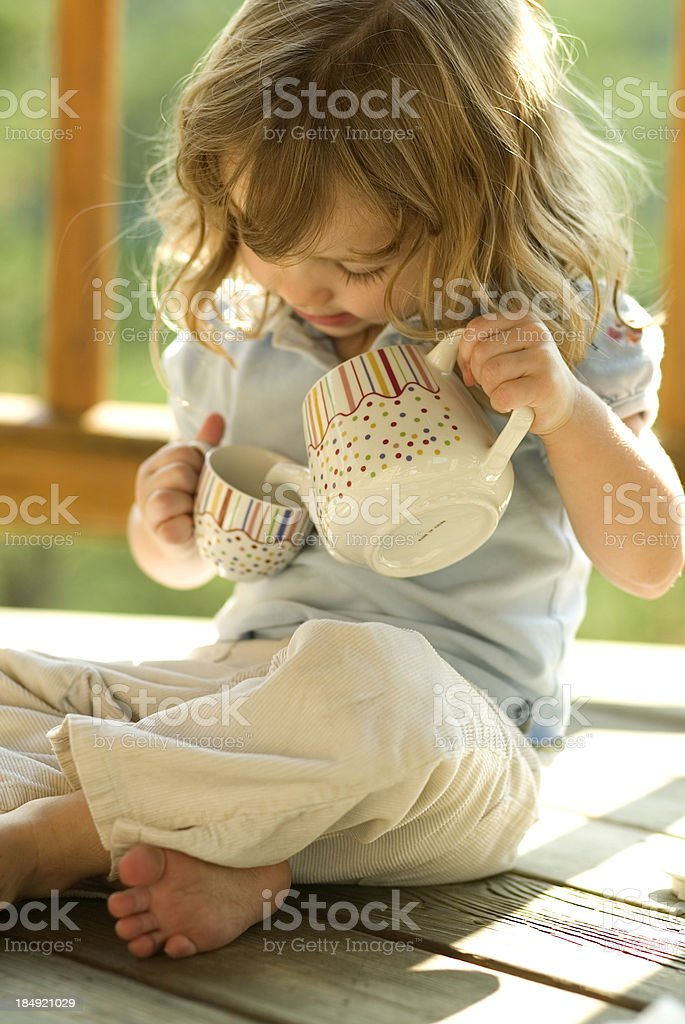 Girl pouring tea royalty-free stock photo