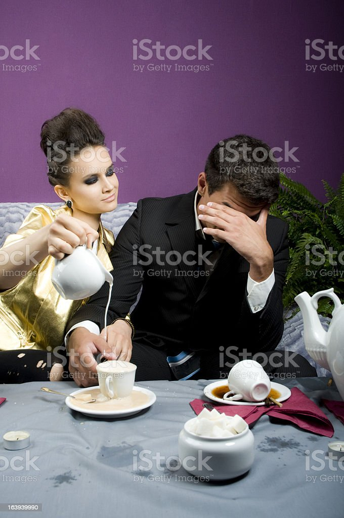 Girl pours milk in coffee of the man royalty-free stock photo