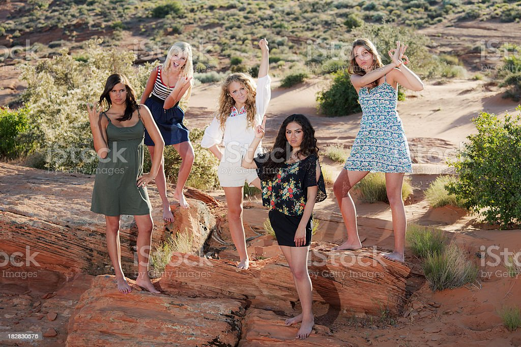 Girl power: five girls in red rock country stock photo