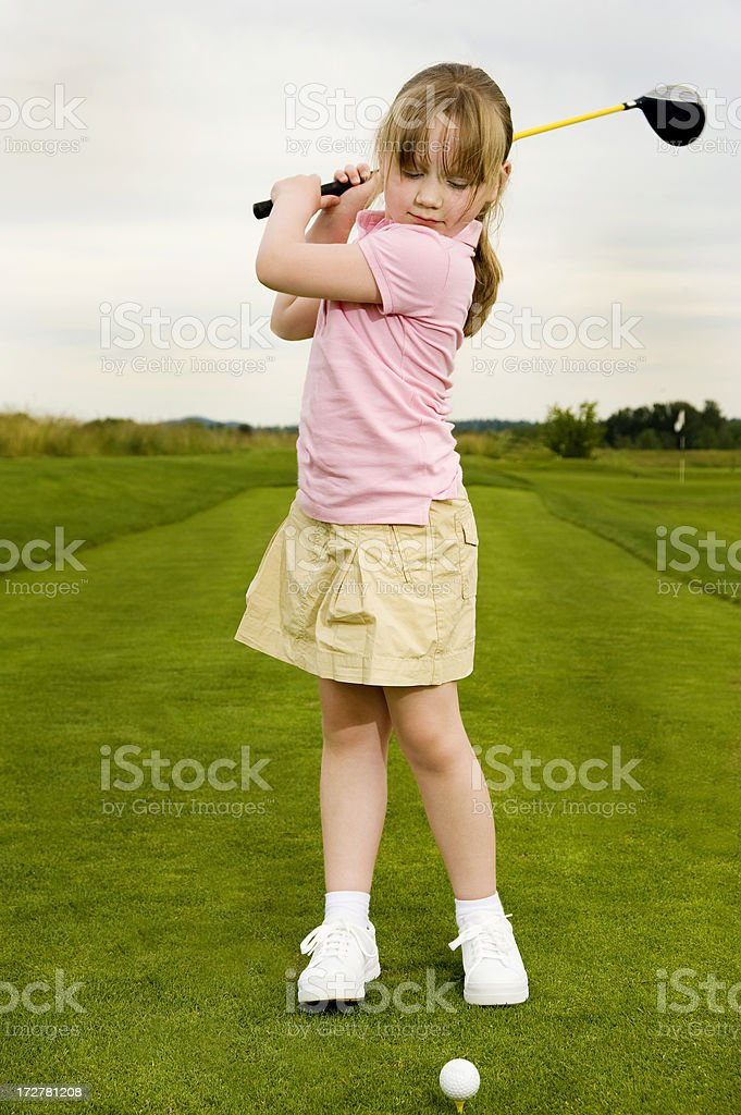 Girl practicing golf swing royalty-free stock photo
