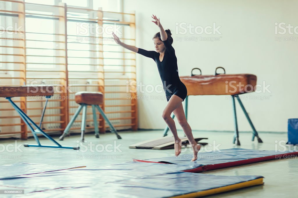 GIrl Practicing Gymnastics. stock photo