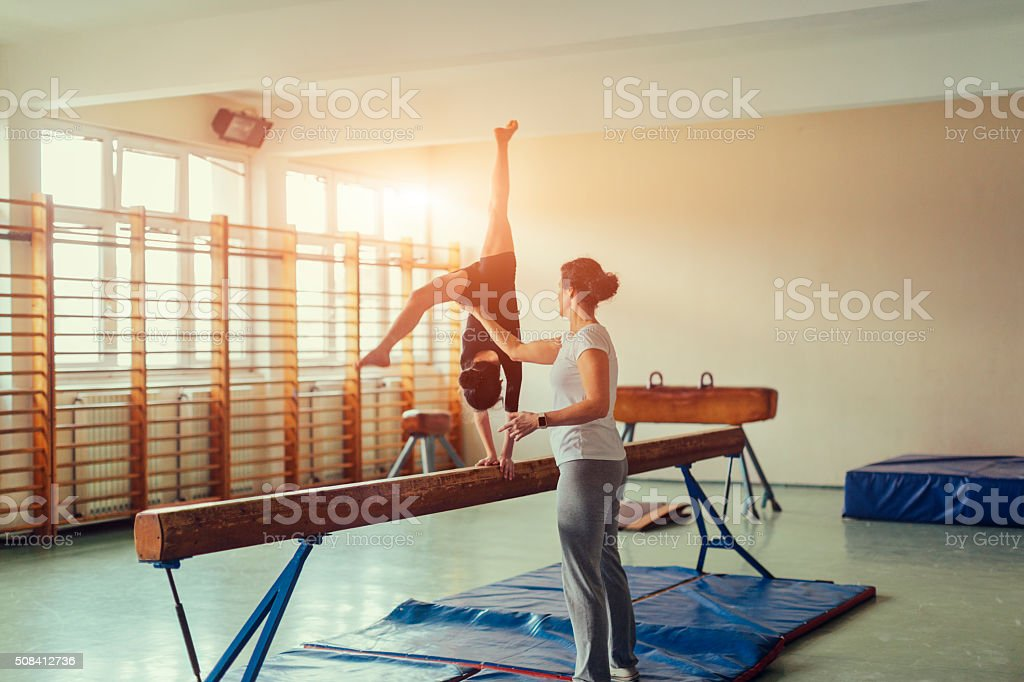 GIrl Practicing Gymnastics stock photo