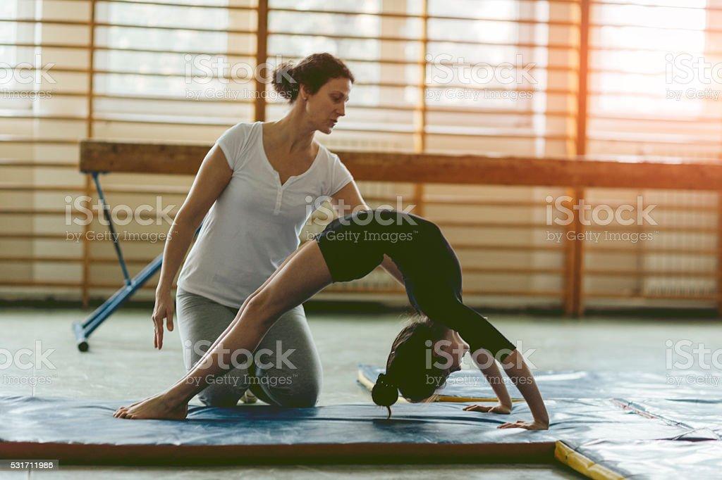 GIrl Practicing Gymnastics stock photo