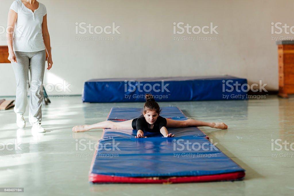 GIrl Practicing Gymnastics. stock photo