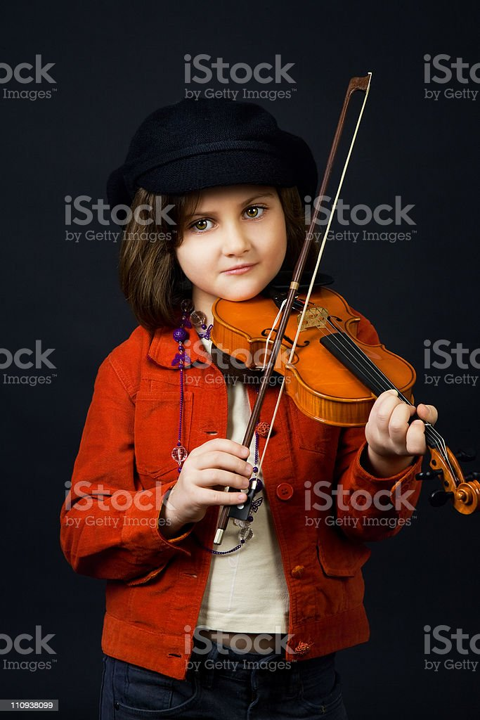 Girl practicing the violin stock photo
