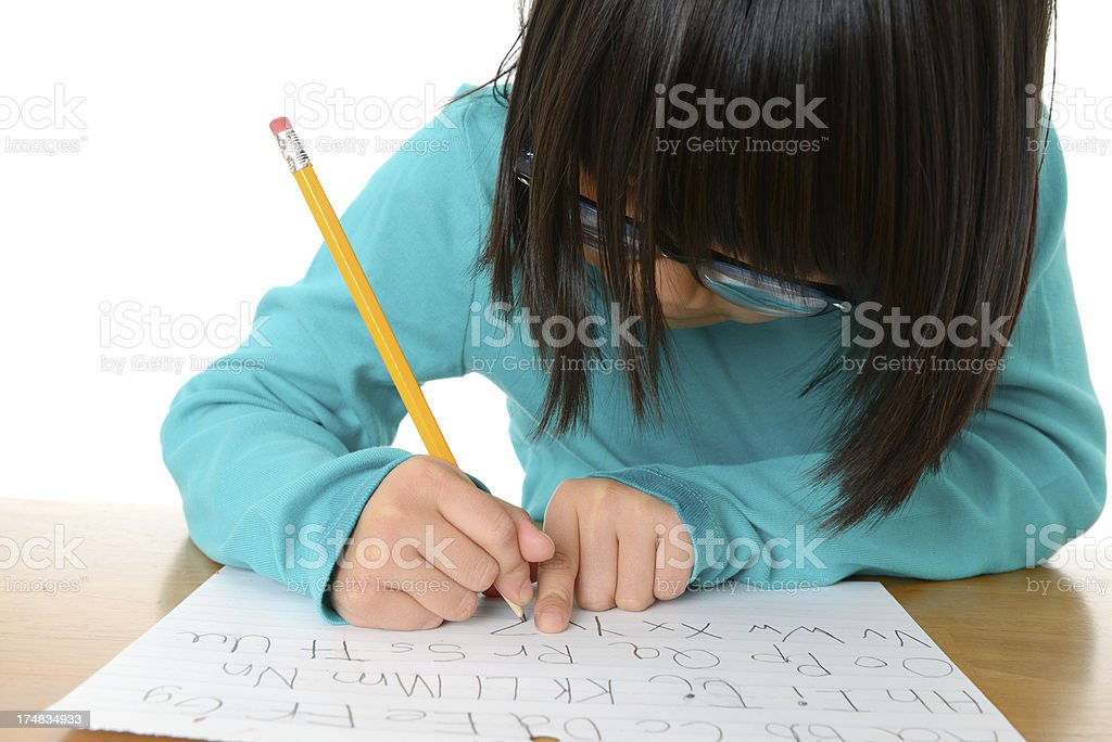 Girl Practicing Writing the Alphabet stock photo