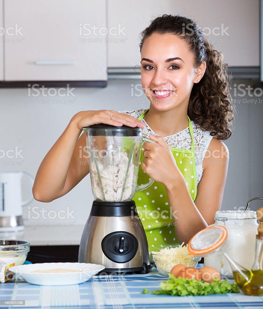 Girl preparing chicken pate stock photo