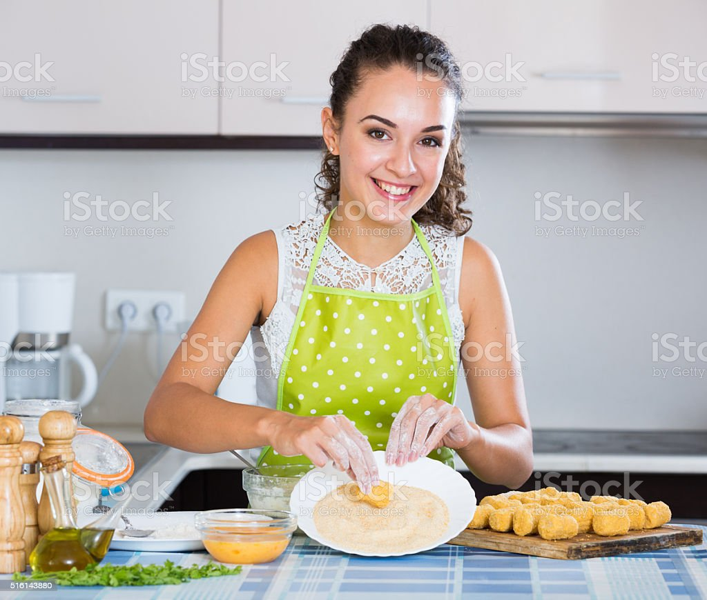 girl preparing croquettes for tasty dinner stock photo