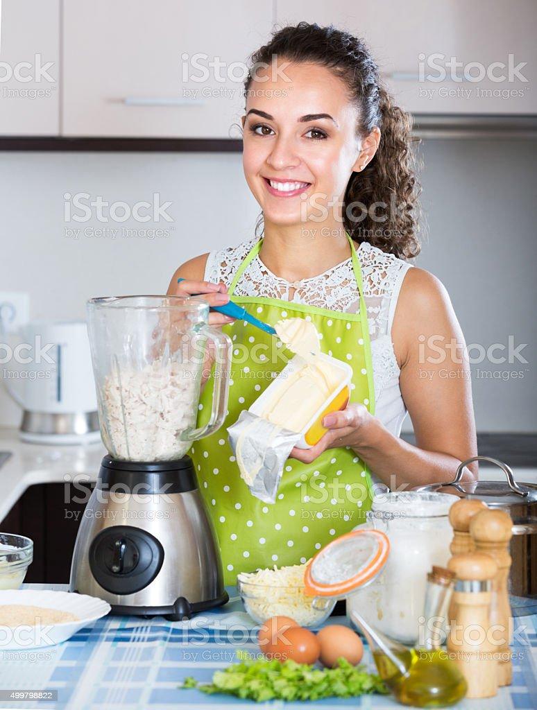 Girl preparing pate with kitchen blender stock photo