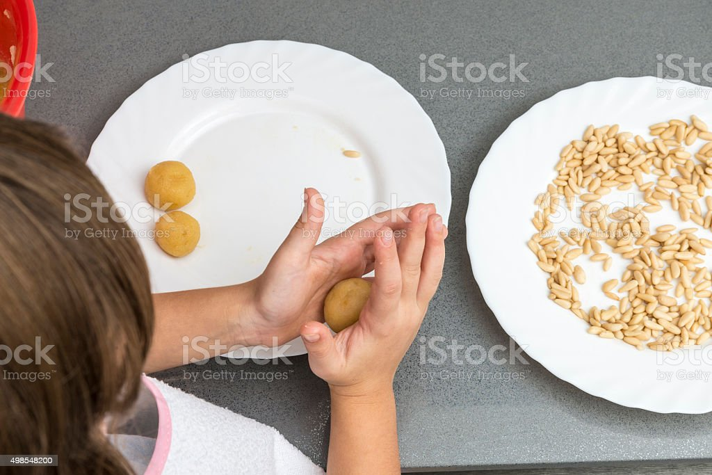 Girl preparing sweets in the kitchen stock photo
