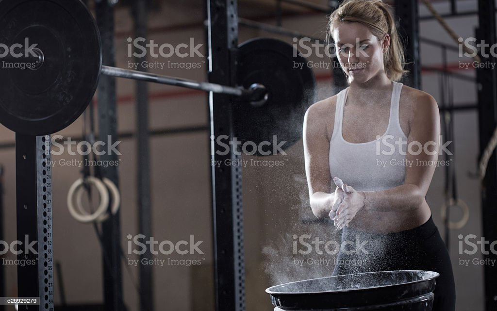 Girl preparing to weightlifting stock photo