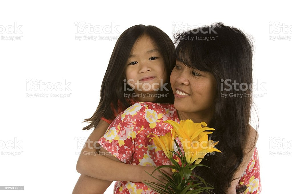 Girl proud of the flower she gave her Mom royalty-free stock photo