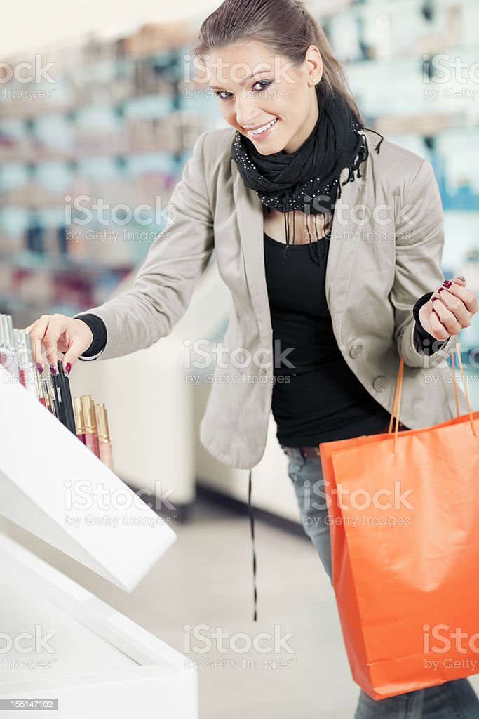 Girl  purchases cosmetics in the mall stock photo
