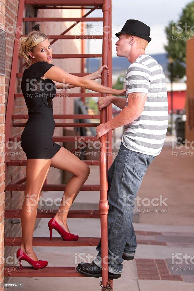 Girl Pushing Boy Away royalty-free stock photo