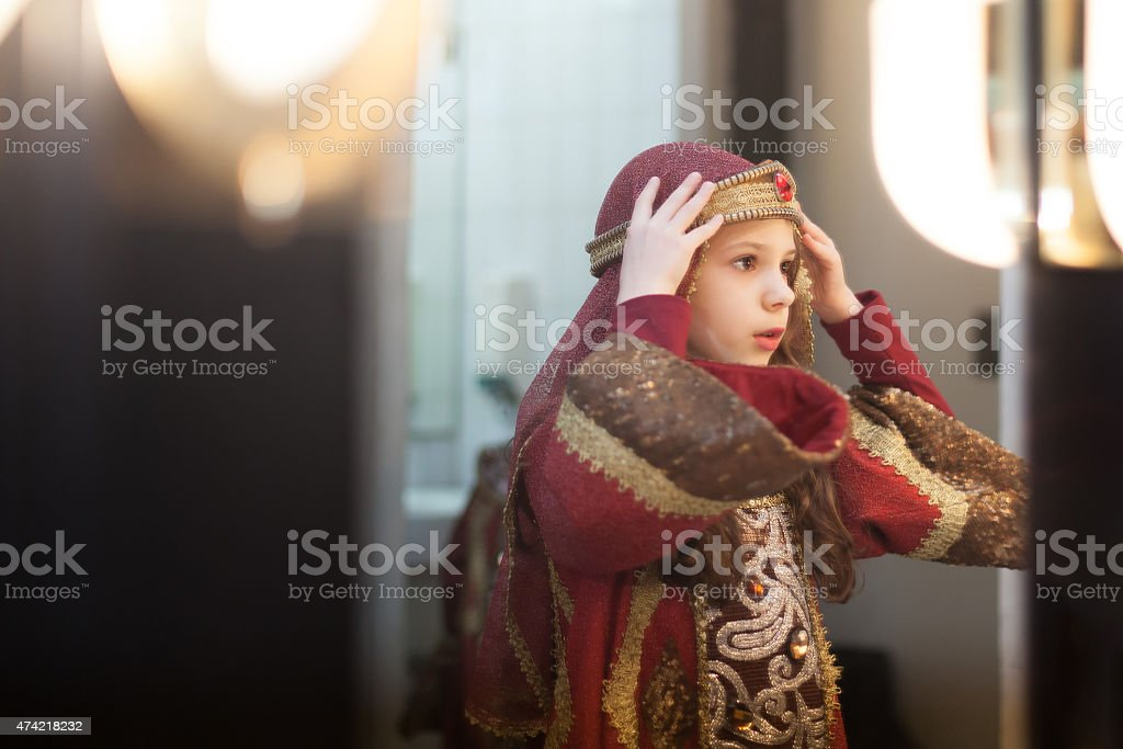 girl putting crown on her head before theater play stock photo