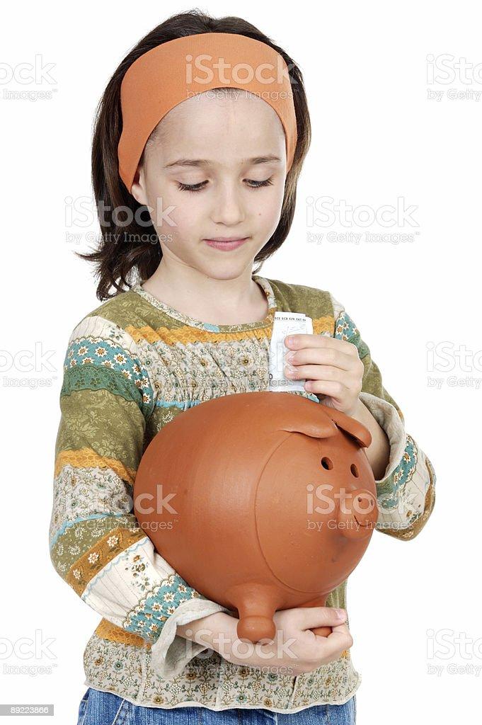 girl putting its savings royalty-free stock photo