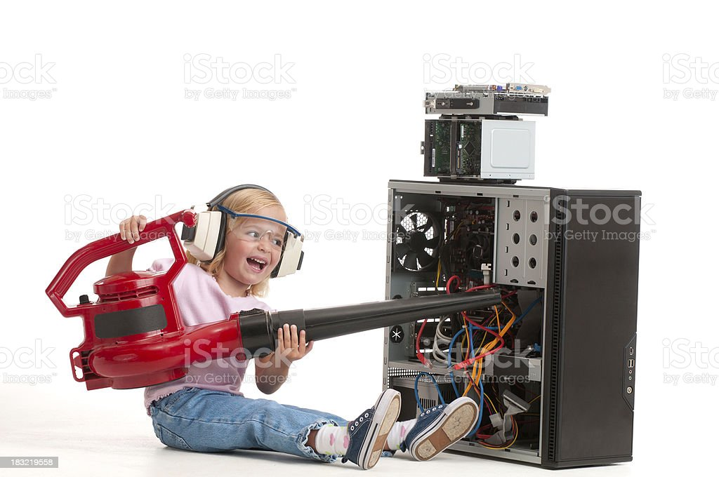"""Girl """"fixing"""" her computer with a leaf blower. stock photo"""