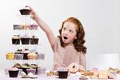Girl reaching for cake
