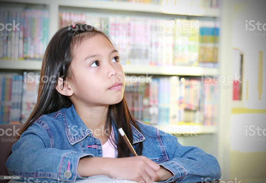 girl reading a book. stock photo