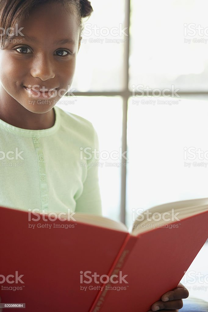 Girl reading a book stock photo