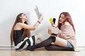girl reading a book VS girl using lots of mobiles