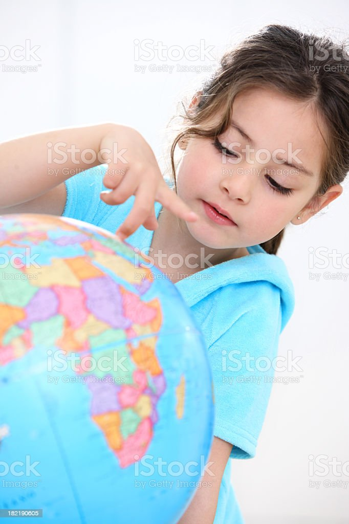 girl reading a globe royalty-free stock photo