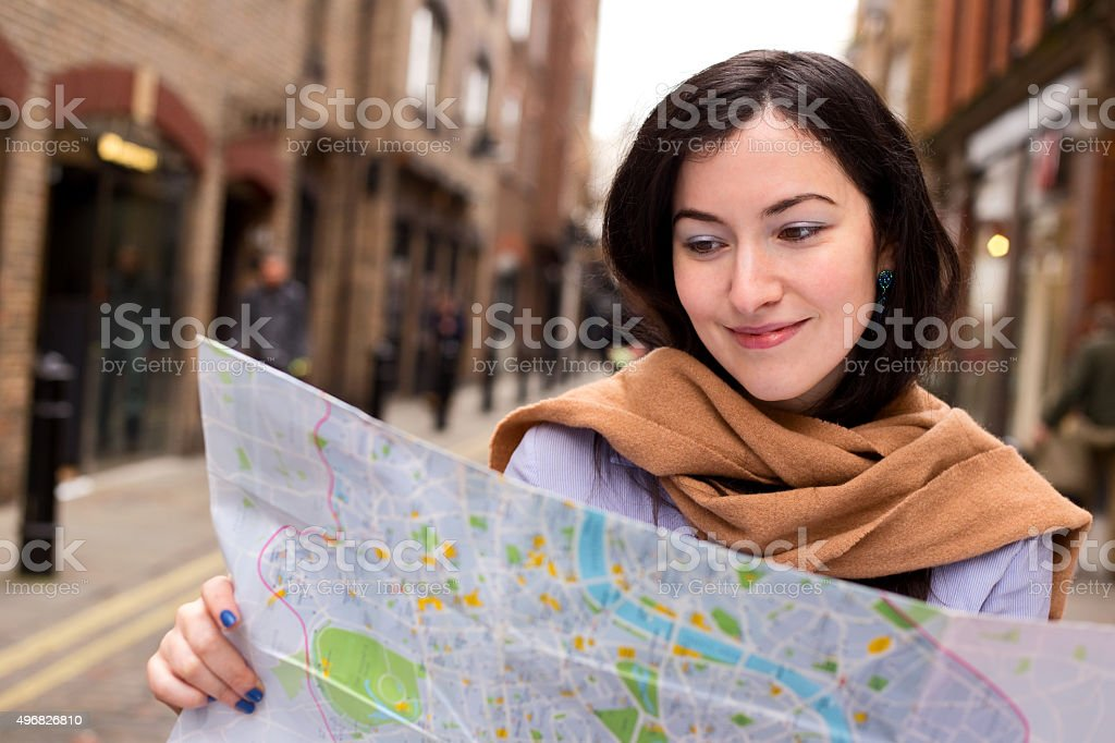 girl reading a map royalty-free stock photo