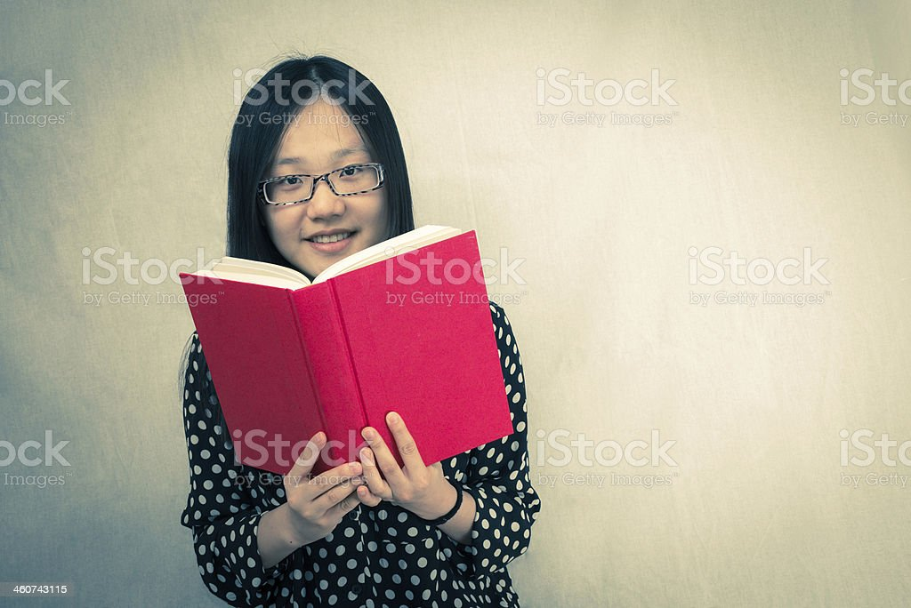 Girl reading a red book royalty-free stock photo