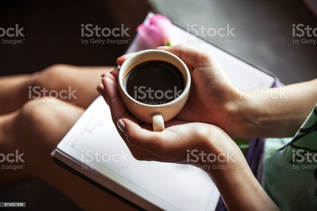 Girl reading book and drinking coffee, beautiful rose. stock photo