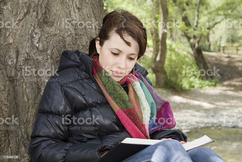 Girl Reading Book by a Tree royalty-free stock photo