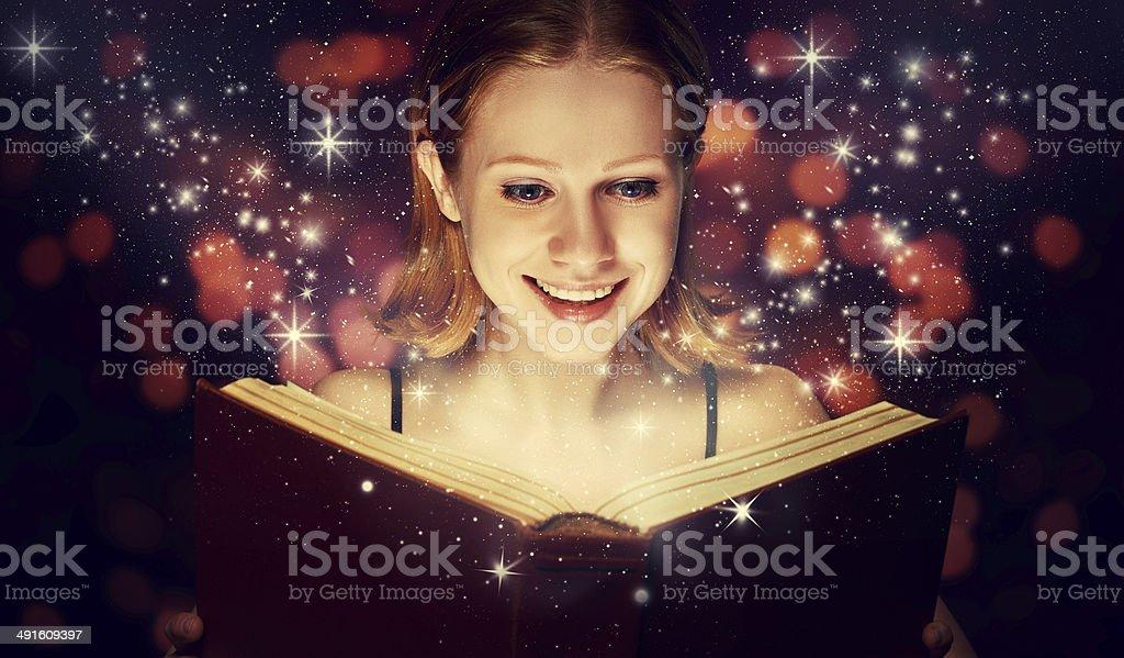 girl reading  magic book royalty-free stock photo
