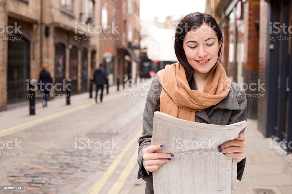 girl reading newspaper royalty-free stock photo