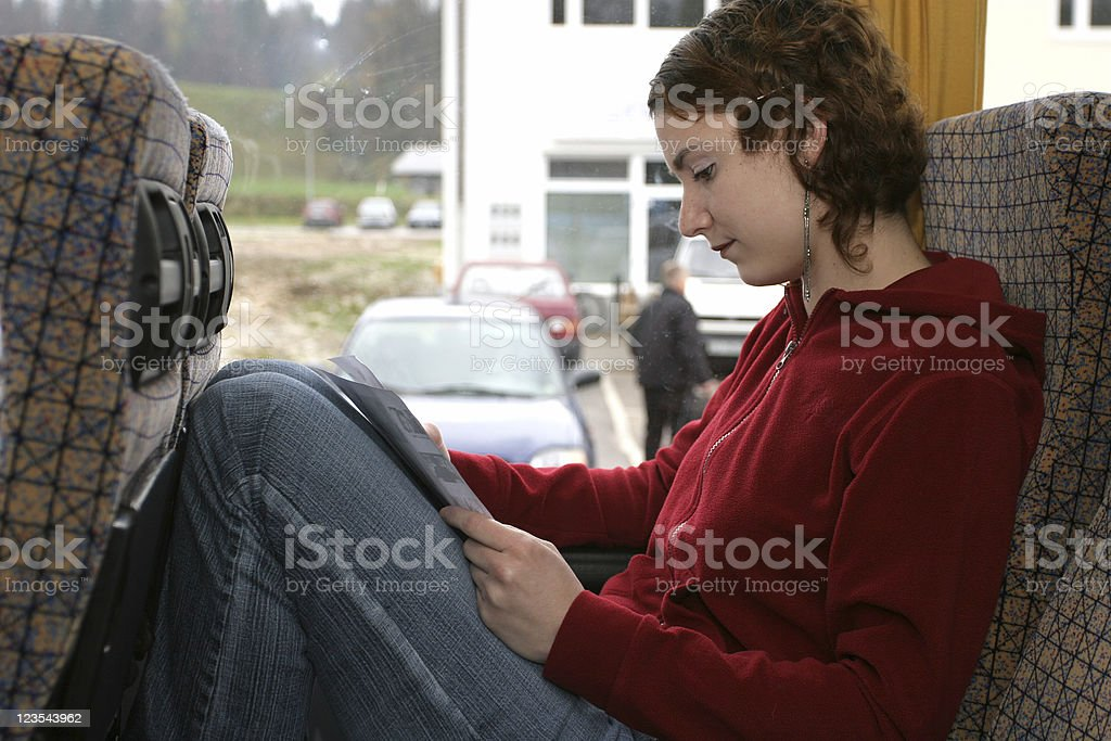 Girl reading on the bus royalty-free stock photo