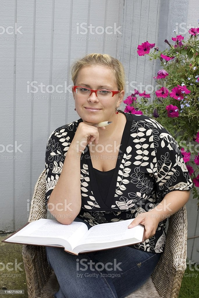 Girl reading studying outside royalty-free stock photo