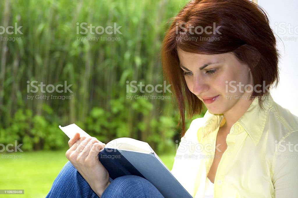 Girl reads book royalty-free stock photo