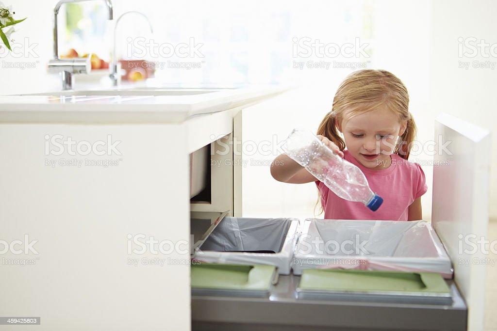Girl Recycling Kitchen Waste In Bin stock photo