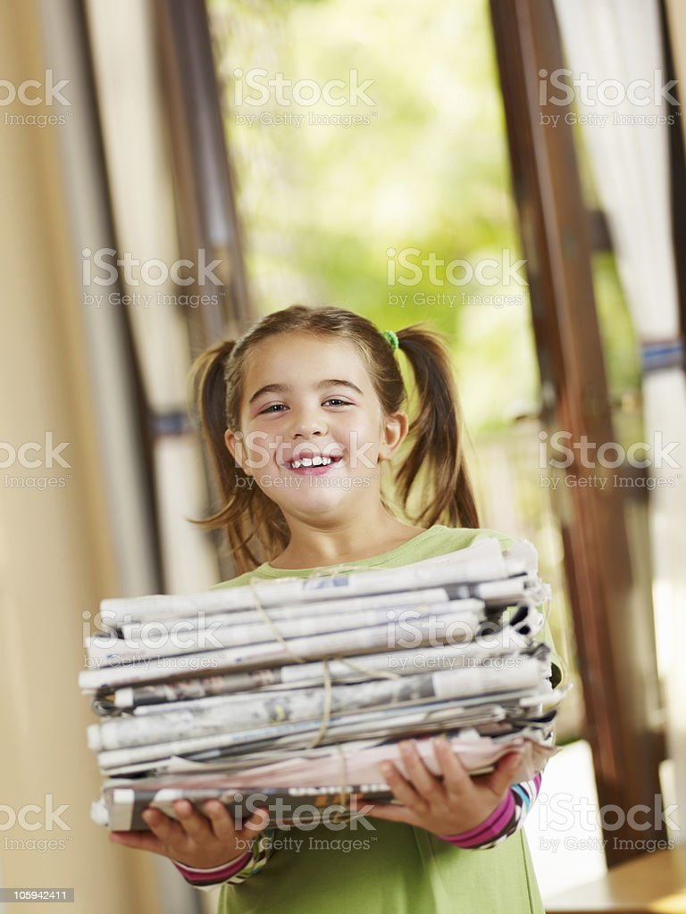 girl recycling newspapers royalty-free stock photo
