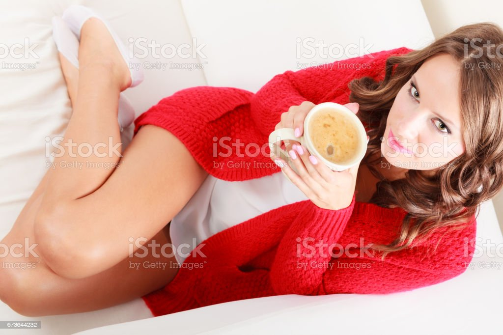 Girl red sweater holds mug with coffee stock photo